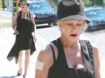She's patching things up! Melanie Griffith displays her legs in black dress while continuing to conceal her 'Antonio' tattoo