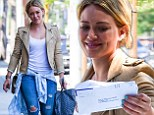 Life is good: Hilary Duff didn't let a parking ticket ruin her day in West Hollywood on Friday