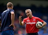 Crystal Palace caretaker manager Keith Millen chats with Brede Hangeland before the Barclays Premier League match at Selhurst Park, London. PRESS ASSOCIATION Photo. Picture date: Saturday August 23, 2014. See PA story SOCCER Palace. Photo credit should read: Andrew Matthews/PA Wire. RESTRICTIONS: Editorial use only. Maximum 45 images during a match. No video emulation or promotion as 'live'. No use in games, competitions, merchandise, betting or single club/player services. No use with unofficial audio, video, data, fixtures or club/league logos.