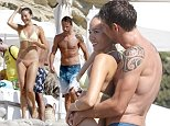 EXCLUSIVE:  Formula 1 driver Jenson Button and girlfriend Jessica Michibata enjoy a refreshing swim at a beach Club in Ibiza.  Pictured: Jenson Button, Jessica Michibata Ref: SPL819825  120814   EXCLUSIVE Picture by: Splash News  Splash News and Pictures Los Angeles:310-821-2666 New York:212-619-2666 London:870-934-2666 photodesk@splashnews.com