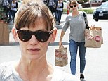 It's a balancing act! Jennifer Garner juggles four heavy grocery bags during solo outing to the store
