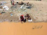 Yazidi child victims of the Isis rampage collect filthy water from a muddy rivulet in Zakho district, a few kilometers from the Iraqi-Turkish border, Dohuk