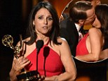 Sealed with a kiss! Thrilled Veep star Julia Louis-Dreyfus locks lips with Bryan Cranston after picking up her FIFTH Emmy