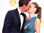 Best kiss on the carpet: Emmy host Seth Meyers and wife Alexi Ashe share a smooch before the Emmy Awards at the Nokia Theatre in Los Angeles on Monday night