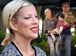 The family that plays together, stays together? Tori Spelling cracks a rare smile during day out in Malibu with husband Dean McDermott and their brood