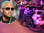 Pictures emerge of armed cops surrounding club where Suge Knight was shot after it is claimed he was chatting to Chris Brown just moments before the incident
