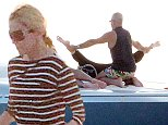 19.AUG.2014 - IBIZA - SPAIN\n*** EXCLUSIVE ALL ROUND PICTURES AVAILABLE FOR UK NEWSPAPERS ONLY ***\n**NOT AVAILABLE FOR ITALY**\nQUEEN OF POP MADONNA SEEN DOING THE SPREAD EAGLE ON A YACHT WHILE ON HOLIDAY IN IBIZA!\nBYLINE MUST READ : XPOSUREPHOTOS.COM\n***UK CLIENTS - PICTURES CONTAINING CHILDREN PLEASE PIXELATE FACE PRIOR TO PUBLICATION ***\n**UK CLIENTS MUST CALL PRIOR TO TV OR ONLINE USAGE PLEASE TELEPHONE  44 208 344 2007 ***