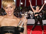 Miley Cyrus makes triumphant return to MTV VMAs... a year after infamous twerking performance with Robin Thicke