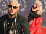 Chris Brown receives hug from Rita Ora as he attends MTV VMAs day after shooting at his pre-party