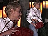 A year ago Miley Cyrus took the world by storm with a scandalous twerk-filled performance with singer Robin Thicke at the Video Music Awards. On the eve of the anniversary of her wild display the 21-year-old actress-singer went out for a sushi dinner where she flashed her toned abs in a rather conservative ensemble for the star.