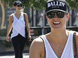 In need of a sweet treat! Kaley Cuoco bares her sculpted arms in a white tank top for post-workout coffee break