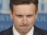 White House Press Secretary Josh Earnest takes the podium at the White House in Washington, Monday, Aug. 25, 2014, where he took questions on ISIS, Iraq, and Syria. (AP Photo/Charles Dharapak)