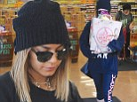 Vanessa Hudgens shows off pins in leggings and dons work-out gear as she grabs groceries from market