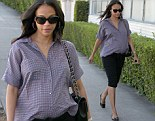 Business attire chic! Zoe Saldana hides baby bump under pencil skirt as she leaves office building in Beverly Hills