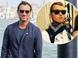 Jude Law's son Rafferty looked the spitting image of his Oscar-nominated father as he posed at the Notting Hill Carnival with his girlfriend Ella Dallaglio, 17, daughter of ex-England rugby captain Lawrence