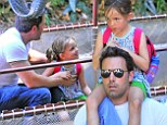 Daddy-daughter Disney day! Ben Affleck dotes on five-year-old Seraphina during a fun outing to The Happiest Place On Earth