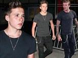 It's baby Becks! Brooklyn Beckham dresses just like his dad David for Ed Sheeran concert