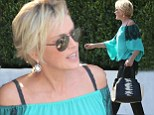 Flirty at 56! Sharon Stone flashes her bra straps in lacy off-the-shoulder top and casual trousers after lunch with friends