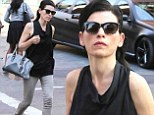 Taking care of business: Julianna Margulies was spotted solo as she stepped out for a stroll in New York City's Soho neighbourhood on Wednesday