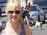 Anna Faris displays lean legs in denim shorts as she takes her beloved dog Bonzo to the vet