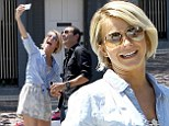2736412 Howdy partner! Julianne Hough takes selfie with old Dancing With The Stars pupil Helio Castroneves next to his race car