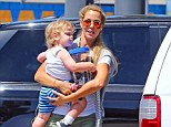 Thighly impressive: Elizabeth Berkley showed off her lovely legs as she went for a stroll with son Sky n Los Angeles on Wednesday