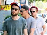 The Hat Pack! Robert Pattinson and Tom Sturridge don caps as they step out with male pal for relaxed lunch