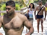 EXCLUSIVE: Boxer Amir Khan and wife Faryal hit the beach in Miami, Florida on Tuesday afternoon. Amir sat texted and used his phone while sitting on sun lounger on his own for an hour before his 22-year-old wife came out to the beach for a few minutes while Amir was cooling off in the ocean. The couple then went back to their luxury room at the Fontainebleau hotel. Reports emerged earlier this week that Amir had bombarded a lap dancer with X-rated messages just days after the birth of his daughter and the dancer claims and she claims he met her five times in a Bolton car park.\n\nPictured: Amir Khan, Faryal Makhdoom\nRef: SPL824646  260814   EXCLUSIVE\nPicture by: Splash News\n\nSplash News and Pictures\nLos Angeles: 310-821-2666\nNew York: 212-619-2666\nLondon: 870-934-2666\nphotodesk@splashnews.com\n