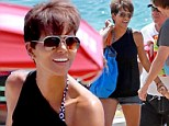 Halle Berry bares her toned legs in denim cutoffs as she enjoys boat ride with her family during Hawaiian holiday