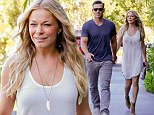Smiling LeAnn Rimes enjoys romantic stroll with Eddie Cibrian... after being slammed on Twitter for controversial rape joke