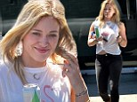 Dare to bare: Hilary Duff showed her midriff in a knotted tank-top on Wednesday while out in Los Angeles