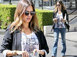 Billion dollar woman: Jessica Alba was spotted in bell bottoms as she stopped by Coffee Bean in Los Angeles Wednesday - a day after the worth of The Honest Company was revealed