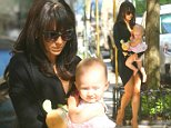Hilaria Baldwin was spotted carrying her baby daughter Carmen to a waiting car near her her in downtown Manhattan.  Pictured: Hilaria Baldwin and Carmen Ref: SPL829228  270814   Picture by: Splash News  Splash News and Pictures Los Angeles: 310-821-2666 New York: 212-619-2666 London: 870-934-2666 photodesk@splashnews.com