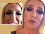 Worrying: Britney gives a pained smile as she posts a video to her millions of followers
