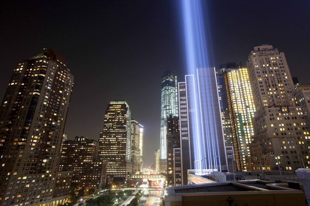 FILE- In this Sept. 10, 2013 file photo, the Tribute in Light rises into the night sky during a test in New York. The National September 11 Memorial and Muse...