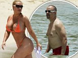 Nice curves... and yours aren't bad either, Coco! Ice-T shows off his beach body while wife puts on an eye-popping display in G-string bikini