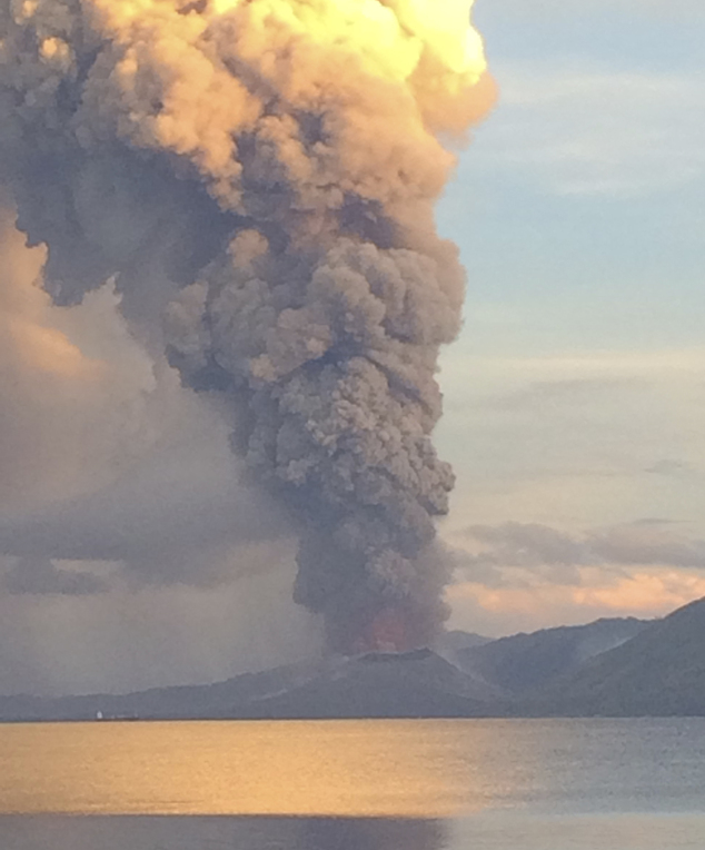 In this photo taken and released by Jason Tassell, a huge smoke billows from Mt. Tavurvu after an eruption in Kokopo, east New Britain, Papua New Guinea, Fri...