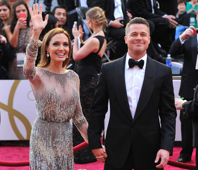 FILE - In this Sunday, March 2, 2014, file photo, Angelina Jolie, left, and Brad Pitt arrive at the Oscars at the Dolby Theatre in Los Angeles. Jolie and Pit...