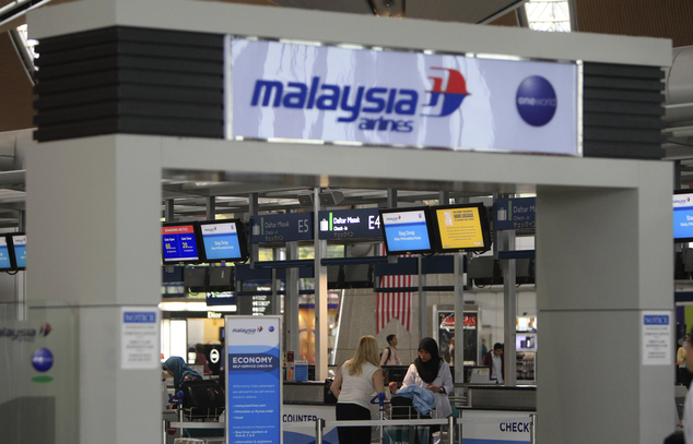 Passengers are ready to check in at a departure lobby at Kuala Lumpur International Airport in Sepang, Malaysia, Friday, Aug. 29, 2014. Malaysia Airlines wil...