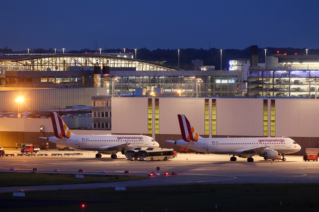 Aircraft of German carrier Germanwings are grounded at the airport in Hamburg, northern Germany, Friday morning, Aug. 29, 2014. Thousands of passengers are f...