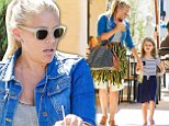 Stylish mommy Busy Philipps keeps up with daughter Birdie in wedge heels and garden-themed skirt