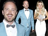 What a great week! Aaron Paul wears dapper blue suit and bow tie for birthday dinner with stunning wife two nights after Emmy win