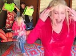 'You're dying to see this hairdo go down the drain, ain't you?' Dolly Parton shrieks her way through ALS ice bucket challenge