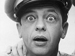 circa 1965:  American actor Don Knotts looks at the camera with a surprised expression, as Andy Griffith holds his hand on his shoulder, posing in character as Deputy Barney Fife and Sheriff Andy Taylor in a publicity still for the television series, 'The Andy Griffith Show'.  (Photo by Hulton Archive/Getty Images)