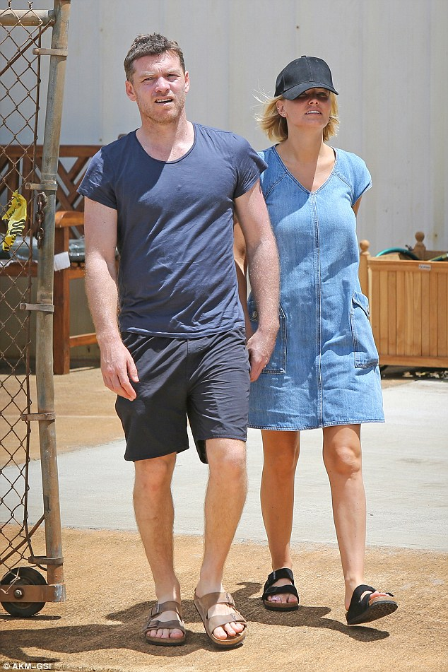 Lucky in love: Sam Worthington and Lara Bingle were spotted walking hand-in-hand in Hawaii on Thursday
