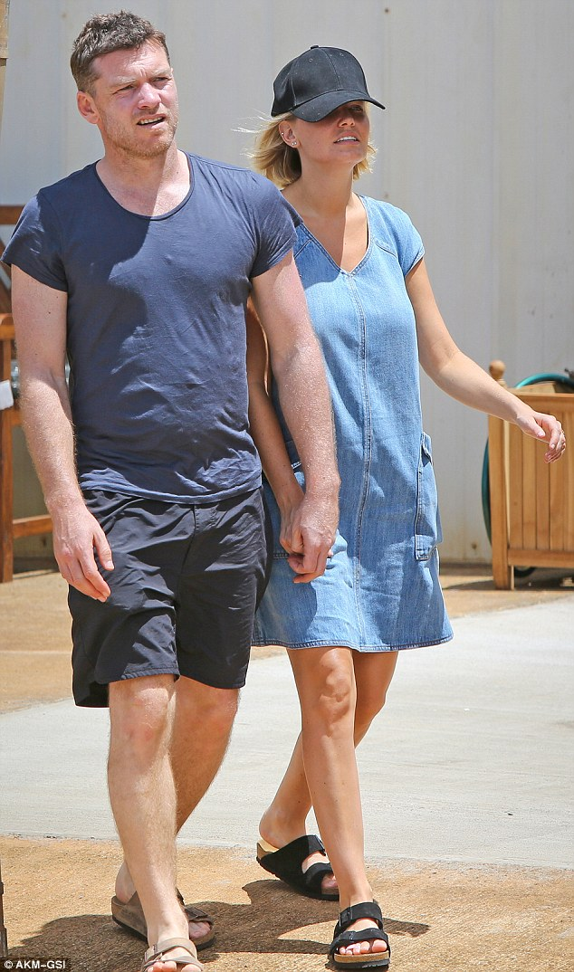 Joined at the hip: Avatar star Sam kept his casual as well, in dark shorts, a navy blue T-shirt and his own Birkenstock sandals in beige
