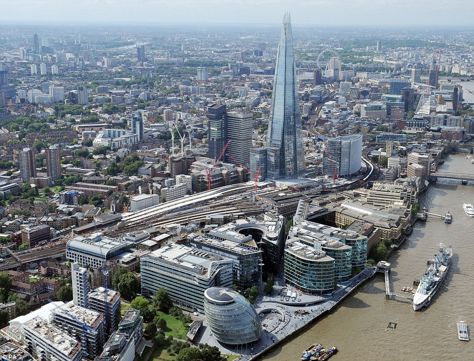 A view of the Shard and London Bridge station with existing platforms (right) and new platforms (left) under construction as part of the £6.5 billion Thameslink rail project