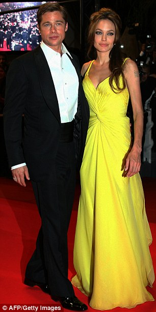 Iconic frock: Waxwork Angelina was dressed in the yellowEmanuel Ungaro frock she wore to the Cannes Film Festival in 2007