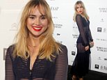 Sao Paulo, Brazil - Suki Waterhouse dons a black sheer dress with matching heels and a gray coat on top as she walks the black carpet for 'Mario Testino in Your Face' event. AKM-GSI          August 28, 2014 To License These Photos, Please Contact : Steve Ginsburg (310) 505-8447 (323) 423-9397 steve@akmgsi.com sales@akmgsi.com or Maria Buda (917) 242-1505 mbuda@akmgsi.com ginsburgspalyinc@gmail.com