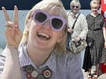Loud and proud! Lena Dunham is typically eye-catching in funky pink sunglasses before glamming up in geometric dress at Venice Film Festival